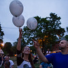 Ashley Teatro of Winchendon and Marcus Cyganiewicz of Gardner release balloons in the air that represent the loved ones they've lost to opiate overdoses.  During the Second Annual International Overdose Awareness Day in Gardner Wednesday night, residents of surrounding towns came together at Monument Park  to remember family and friends who have suffered the tragic consequences of the opiate epidemic. SENTINEL & ENTERPRISE/JEFF PORTER