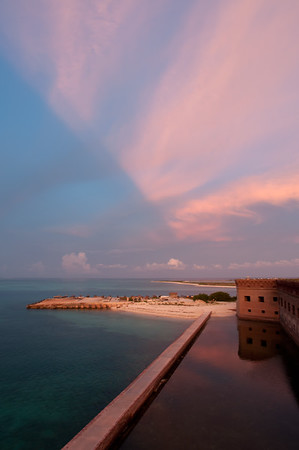 Brilliant pink clouds over Fort Jefferson at sunset in teh Dry Tortugas.