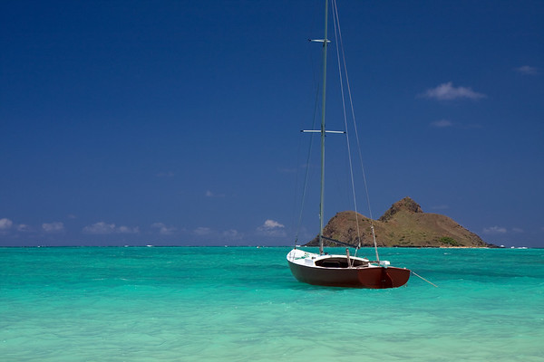 A boat anchored off the shores of Lanikai Beach with one of the two Mokolua Islands in the distance. We had a great time at this beach, and really enjoyed the beautiful waters and fine white sand.