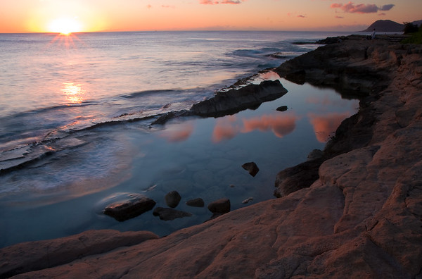 Sunset at Ko Olina. The tide pool has some cool reflections of the clouds, and my favorite part of this picture is how the wave was just big enough to start filling the pool.