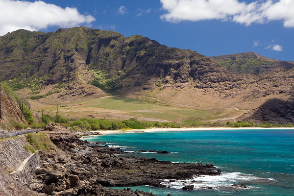 The Waianae Coastline with the rugged Waianae mountain range serving as the backdrop.
