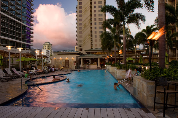 We stayed at the Embassy suites Waikiki for our entire trip...this is a picture of the pool taken at sunset. It's a good (not great) hotel that we chose for several reasons:  1) Breakfast included - lots of fresh fruit, omelettes made to order, juice, coffee, etc. Great way to save some $ and start the day off right. 2) Managers reception at night. Free drinks, food and entertainment from 5:30 - 7:30 each night. Nice to come home from a day of sightseeing and have a beverage near the pool (which is what we were doing when I took this picture)\ 3) Just across the street from Waikiki Beach. 4) Lots of restaurants and shopping nearby so very convenient when you've got a little one traveling with you. We ended up doing a lot of carryout from the nearby Yardhouse restaurant (great food).