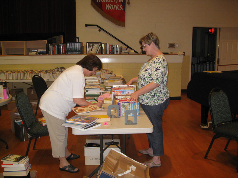 Anne and Pam sorting books.