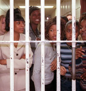 Students from Pontiac Northern High School peer through the bars of a jail cell during their student tour of the Oakland County jail.