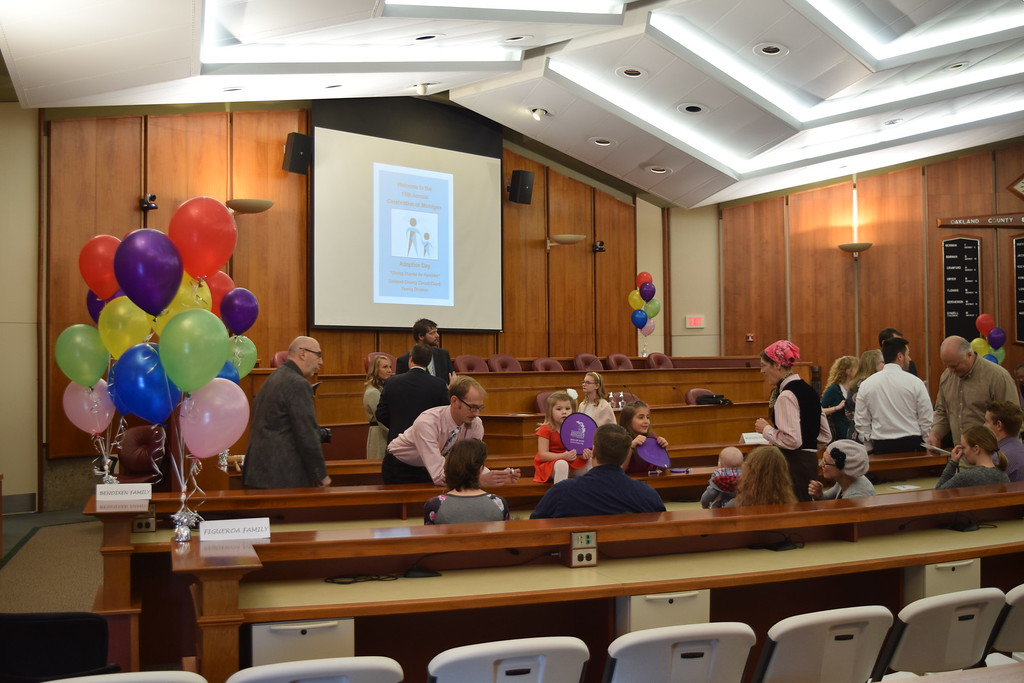 . Seven adoptions were finalized at the Oakland County Board of Commissioners Auditorium, 1200 N. Telegraph Road, Pontiac, Mich., on Tuesday, Nov. 21, 2017 as part of Michigan Adoption Day. Over 30 other courts around the state held their own finalization ceremonies. (Mark Cavitt/The Oakland Press)