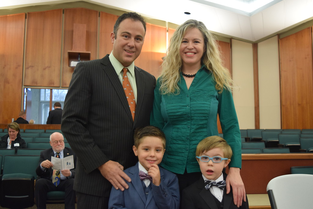 . Nathaniel Figueroa (left) with wife Keely and newly adopted sons George and Christopher. Seven adoptions were finalized at the Oakland County Board of Commissioners Auditorium, 1200 N. Telegraph Road, Pontiac, Mich., on Tuesday, Nov. 21, 2017 as part of Michigan Adoption Day. Over 30 other courts around the state held their own finalization ceremonies. (Mark Cavitt/The Oakland Press)
