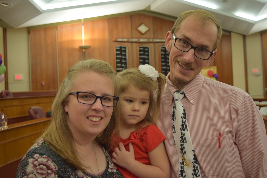 . Jeriah Bendixen (right) with wife Aurora and newly adopted daughter Brooklyn. Seven adoptions were finalized at the Oakland County Board of Commissioners Auditorium, 1200 N. Telegraph Road, Pontiac, Mich., on Tuesday, Nov. 21, 2017 as part of Michigan Adoption Day. Over 30 other courts around the state held their own finalization ceremonies. (Mark Cavitt/The Oakland Press)