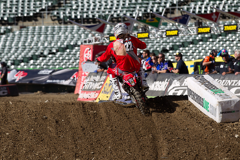 Lompoc Supercross Racer Challenges The Sports Elite<br /> <br /> 10's of Thousands of race fans jammed the Oakland Alameda Coliseum for the 5th round of Monster Energy AMA Supercross on February 3rd. What a night it was, with sunny skies overhead and unseasonable warm weather, had the makings of a night to remember. For Adam Enticknap, the road to success began months prior to Saturday nights race.<br /> <br /> Starting in October both Adam and younger Brother Tyler trained full time with top series contenders Ken Roczen and Adam Cianciarulo at the nearby Los Alomos Supercross track, a huge advantage for both. Lap after lap with continued training at the Gym, served more as a boot camp over the course of the several months. The hard training regimen provided both with renewed focus and determination have proved very beneficial for the Lompoc AMA Pro Racers. Adam meet his carrier goal at the first round at Anaheim with a convincing heat race placement to advance directly to the Main event. This was key as there are new Racers vying for the 22 man Main Event gate. Adam has continued to advance to other Main events and in doing so, scored championship points. Tyler will unfortunately miss this round and several other races as he recuperates from an earlier injury. He is expected to be back racing with his Brother in 4 to 6 months.<br /> <br /> Adam came into the night feeling really good. But during practice the ruts in the track became really gnarly and deep, this is were Adam had some struggles as the track got rougher as the practice sessions continued to reshape the track. One section after the dragons back going into a rhythm section he lost many a second and a half to Guys he normally rides with.  <br /> <br /> Adam was seeded 14th in the 20 man 450SX in the 2nd heat race. The gate dropped and Adam got his Honda 450 around the 1st corner clean and in good shape and after one lap was in 8th place. The battle for several laps took place as Adam was fighting for the