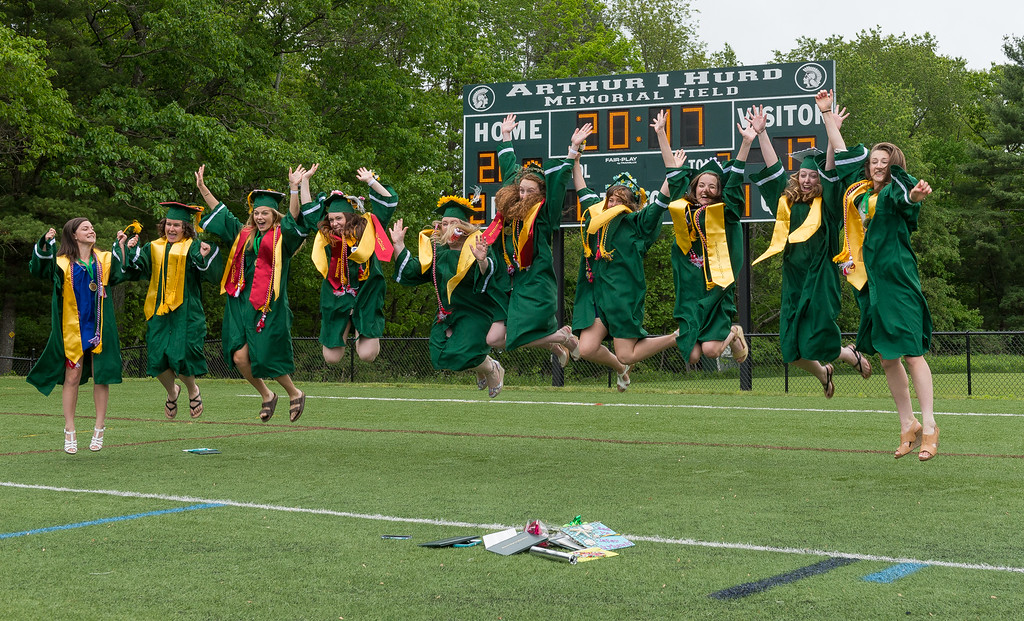 . A bevy of Best Friends; (l-r) Brianna Richard, Jayme Davis, Kaylin Ciesluk, Emily Buchanan, Bridget Sheehan, Chloe O\'Hara, Chanelle Goguen, Maura LeBlanc, Megan Lupinkski and Taylor Ladue get some air after the  Oakmont Regional High School Class of 2017 Commencement. SENTINEL&ENTERPRISE/ Jim Marabello