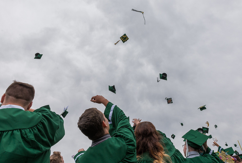 . The traditional \'Flight of the Mortarboards\' at the Oakmont Regional High School Class of 2017 Commencement. SENTINEL&ENTERPRISE/ Jim Marabello