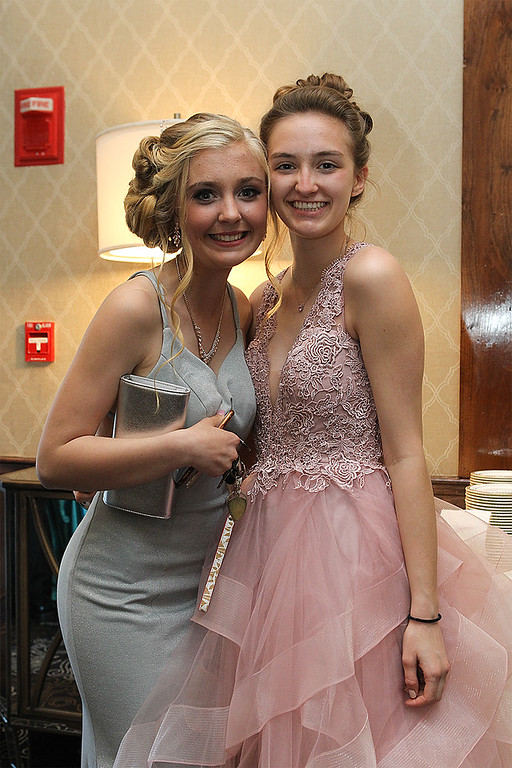 . Olivia Boucher Nicolette Damico show off there beautiful gowns and smiles for the prom -Courtesy photo