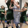 Lunenburg Middle High School girls basketball team played a home game against Oakmont Regional High School on Tuesday afternoon. LMHS player Sarah Morse tries to get by ORHS players Kylie Lison and Hannah Cravedi as she goes to the hoop. SENTINEL & ENTERPRISE/JOHN LOVE