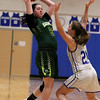 Lunenburg Middle High School girls basketball team played a home game against Oakmont Regional High School on Tuesday afternoon. LMHS player Emily Dumford covers ORHS player Kylie Lison as she looks for a teammate to pass to. SENTINEL & ENTERPRISE/JOHN LOVE