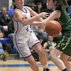Lunenburg Middle High School girls basketball team played a home game against Oakmont Regional High School on Tuesday afternoon. LMHS player Olivia Proctor ties to get a pass by ORHS player Cassidie Lison before falling out of bounds during action in the game SENTINEL & ENTERPRISE/JOHN LOVE