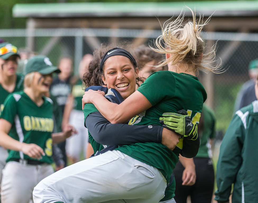 . Oakmont RF Erika Hall celebrates a win over Nipmuc by jumping into the arms of catcher Rachel Sinclair in the Central Mass. Division 2 quarterfinals. Oakmont defeated Nipmuc, 5-0, on Saturday, June 3, 2017, in Ashburnham. SENTINEL&ENTERPRISE/ Jim Marabello