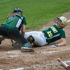 Oakmont 1B Hannah Jensen is tagged out at the plate by Nipmuc catcher Rebecca Rausch in the  Central Mass. Division 2 quarterfinals. SENTINEL&ENTERPRISE/ Jim Marabello