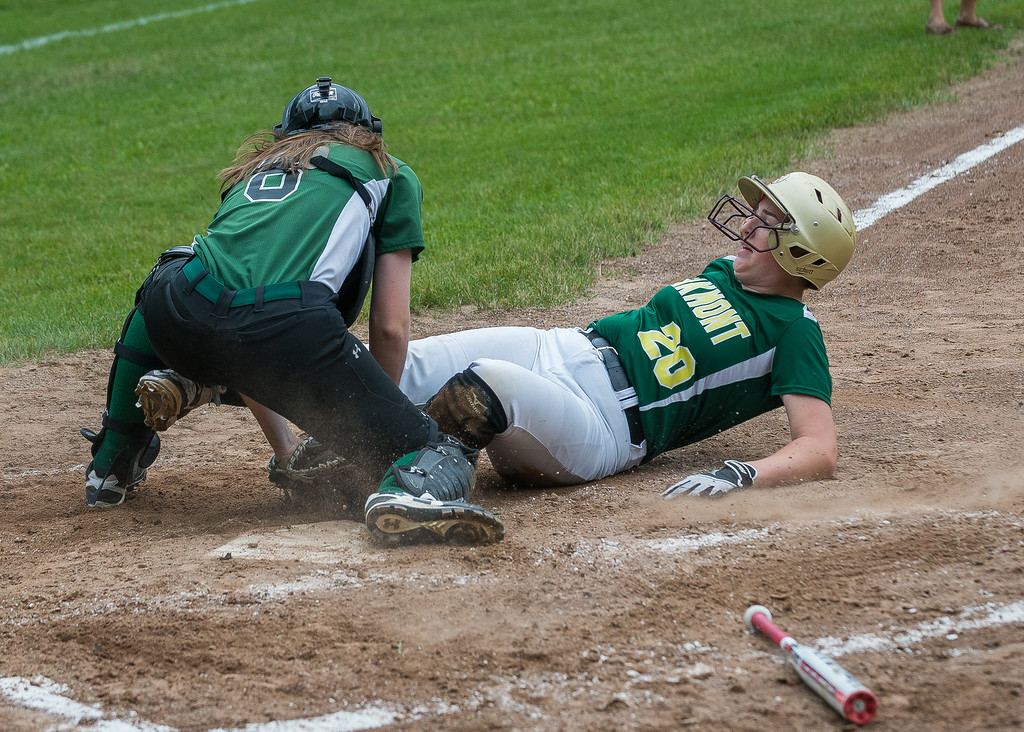 . Oakmont 1B Hannah Jensen is tagged out at the plate by Nipmuc catcher Rebecca Rausch in the  Central Mass. Division 2 quarterfinals. SENTINEL&ENTERPRISE/ Jim Marabello