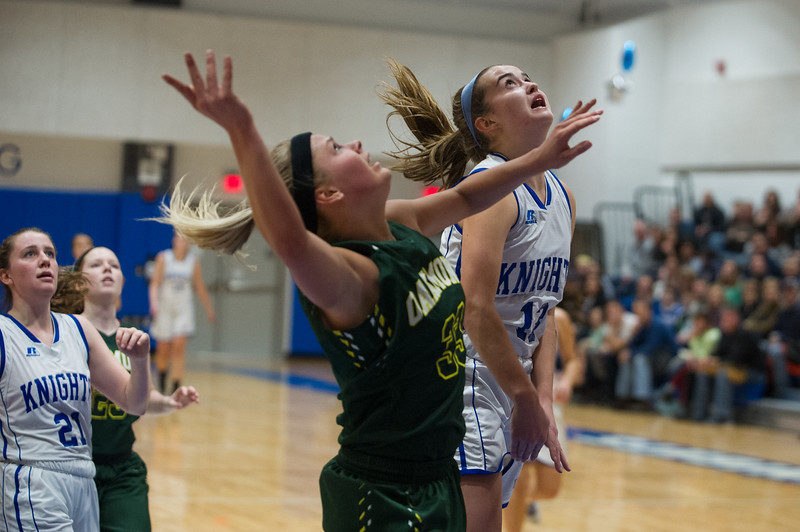 Erika Hall of Oakmont (left) and Elise Lilly of Lunenurg (right) battle under the net during Friday nights game between Oakmont and Lunenburg inside Lunenburg's new facility on Friday, Dec. 9, 2016. Oakmont won, 57-44. Sentinel & Enterprise photo/Jeff Porter