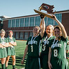 Oakmont's Taylor Ladue, Katherine Haschig and Katherine Arsenault raise the runner-up trophy after falling to Watertown 4-3 in the Division 2 state championship game on Saturday afternoon at WPI. SENTINEL & ENTERPRISE / Ashley Green