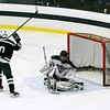 Kyle Thibault in front of the net after Ryan Peralta gets the goal