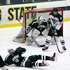 Brendan McGuirk goes down in attempt to block the shot for his goalie Greg Mattson