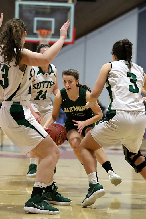 . Oakmont Regional High School player Hannah Cravediis surounded by Sutton High Schools players at Kneller Athletic Center at Clark University on Thursday, March 8, 2018 during the division III semi-finals. SENTINEL & ENTERPRISE/JOHN LOVE