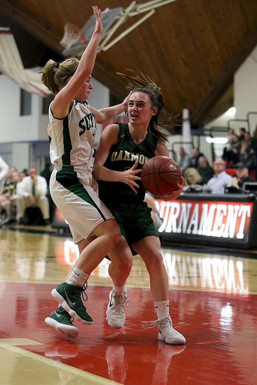 . Oakmont Regional High School player Audrey Dolan gers fouled by Sutton High Schools Lauren Arthaud at Kneller Athletic Center at Clark University on Thursday, March 8, 2018 during the division III semi-finals. SENTINEL & ENTERPRISE/JOHN LOVE