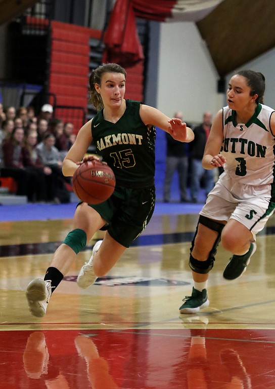 . Oakmont Regional High School player Hannah Cravedi brings the ball down court while being followed by Sutton High Schools Carmen Nieves at Kneller Athletic Center at Clark University on Thursday, March 8, 2018 during the division III semi-finals. SENTINEL & ENTERPRISE/JOHN LOVE