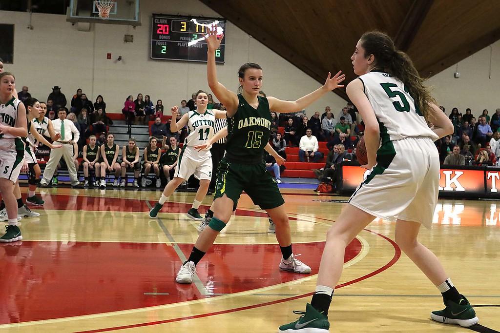 . Oakmont Regional High School player Hannah Cravedi plays covers Sutton High Schools Hannah Nichols at Kneller Athletic Center at Clark University on Thursday, March 8, 2018 during the division III semi-finals. SENTINEL & ENTERPRISE/JOHN LOVE