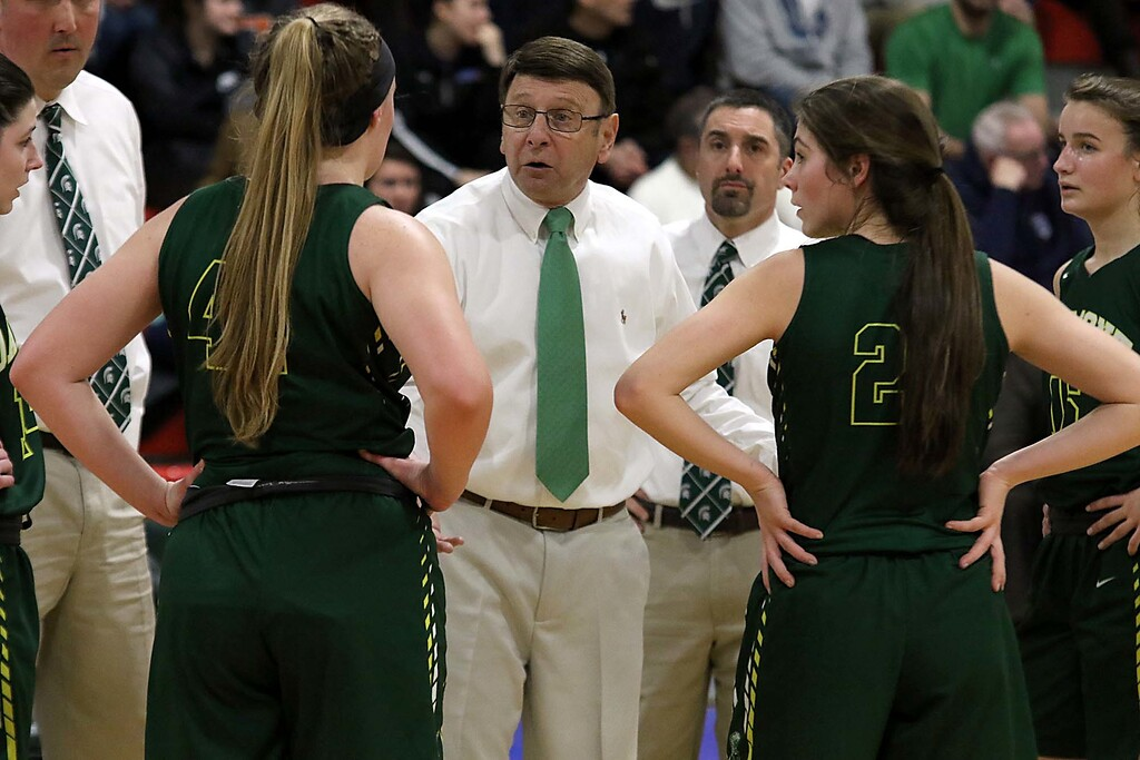 . Oakmont Regional High School head coach Jeff O\'Neill talks to his team during a time out during their match up with Sutton High School at Kneller Athletic Center at Clark University on Thursday, March 8, 2018 during the division III semi-finals. SENTINEL & ENTERPRISE/JOHN LOVE