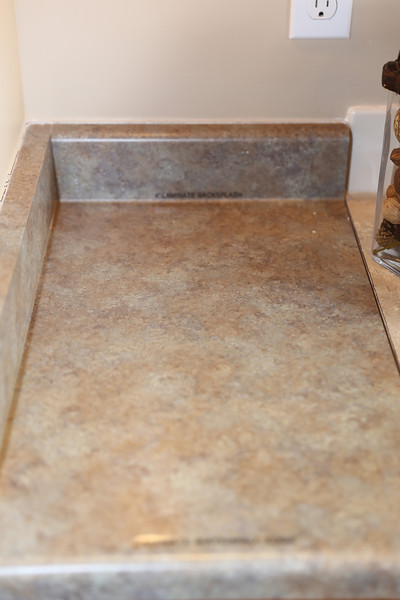 To request no back splash you must pay $120 for Master bathroom mount of mirror and $60. 00 for bath #2.