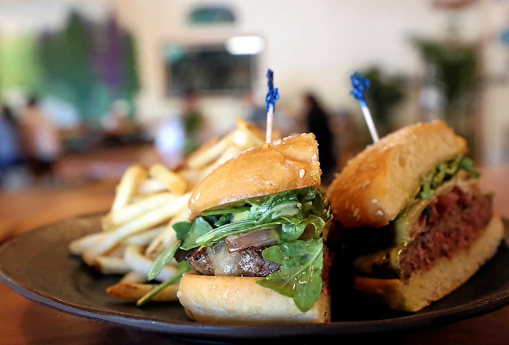 . The Matambre Burger at Oasis is made with beer fro El Salchichero, white cheddar cheese, local greens, pickled charred onions and top with green goddess. (Shmuel Thaler -- Santa Cruz Sentinel)