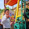 Ride operator at Carmen Alto fair, Oaxaca