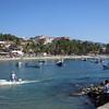 Looking At The Fishing Boats In The Bay And At The Playa Principal