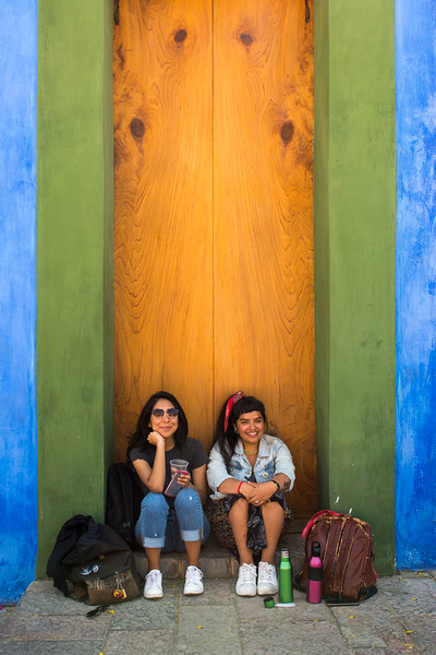 Two Girls by the Blue Wall