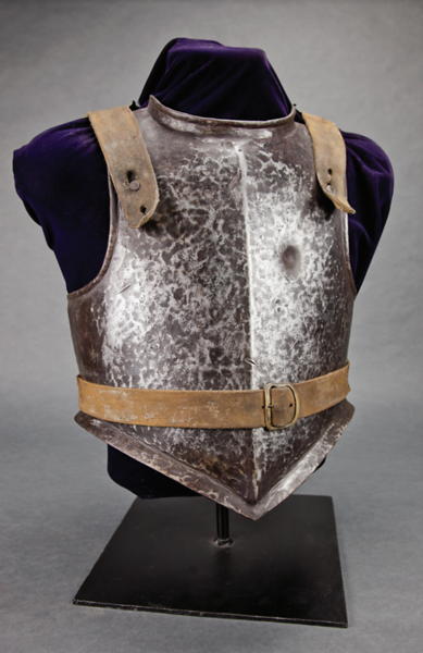 Metal torso plate with leather straps