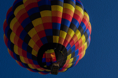 Balloon in flight at the 2013 Great Midwest Balloon Fest. Added oil painting effect.