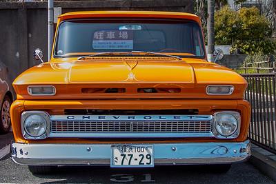 A beautiful orange vintage Chevrolet pickup in Kamakura
