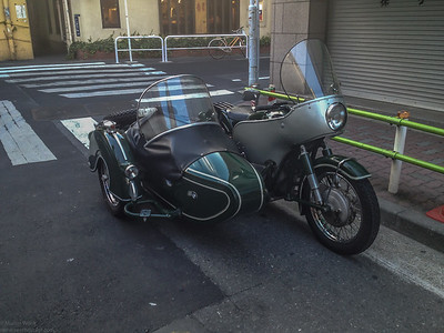 An old BMW bike with sidecar in great condition.