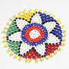 Beaded coaster with flower motif