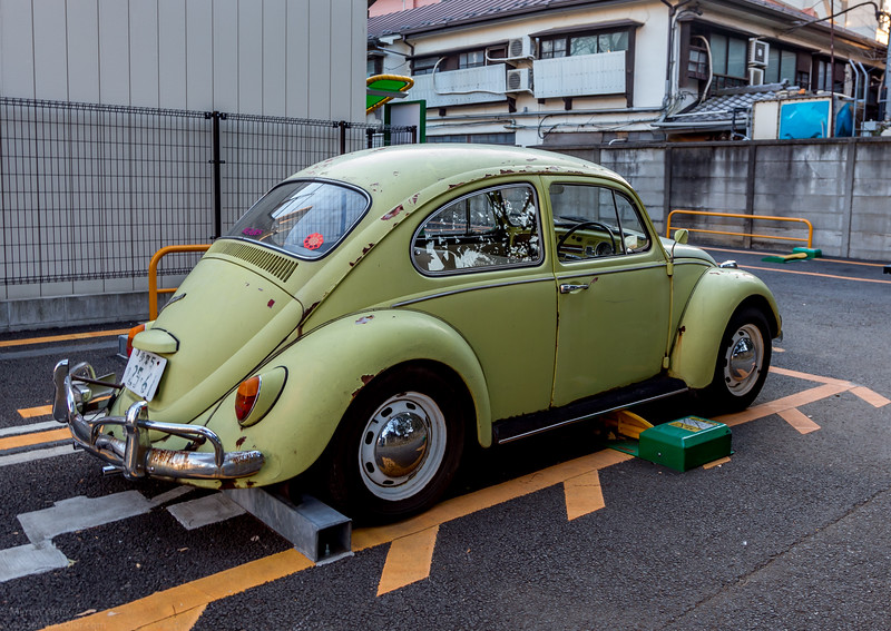 A rusty beetle from mid 1960 recently seen in Tokyo. Still roadworthy it seems being parked on a paying slot.