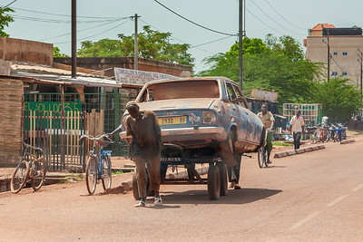 Peugeot 504 on the way to repairs in Koudougou, Burkina Faso. This model came out in 1968 when I was ten years old. 43 years later they can regularly be seen in traffic in Western Africa.