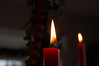 Two Dark Red Christmas Candles