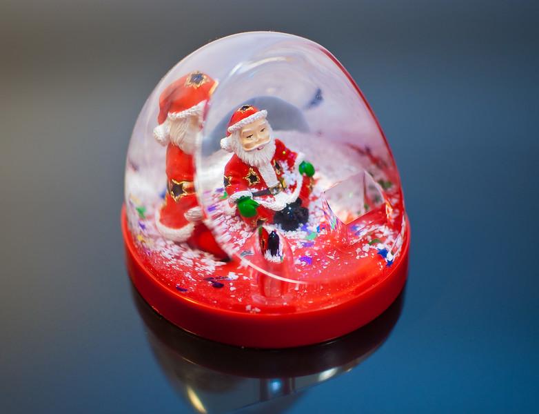 Santa Claus toy on black ice