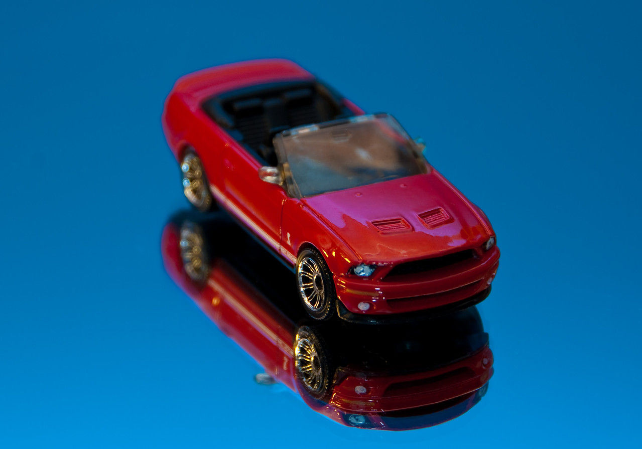 Hot wheels car on mirror