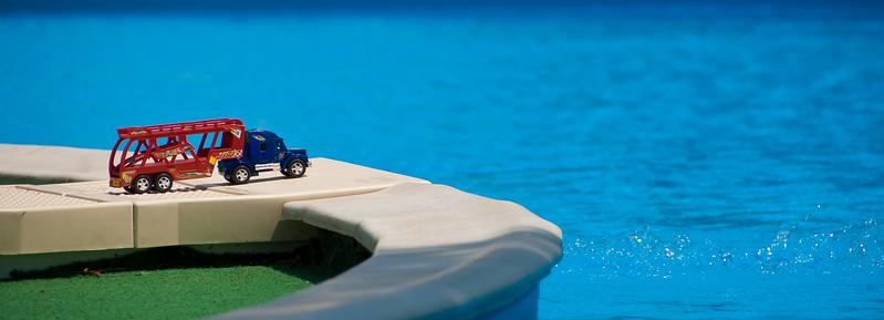 Toy truck near pool