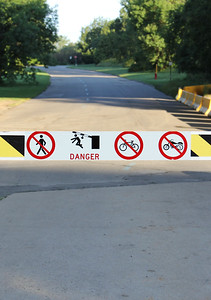 Road Gate with Danger and Interdiction Signs