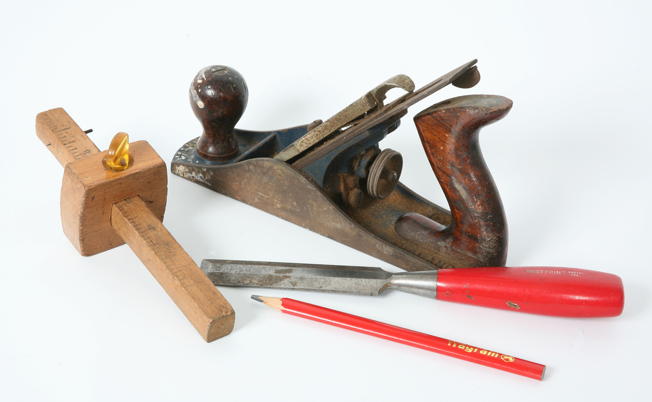 Tools for woodwork: mortice guage, chisel, plane and pencil