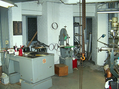 Bandsaw & hoist in the machine shop.