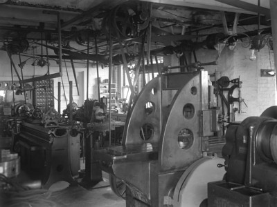 """This image dates back many years ago between 1900 to about 1910 and is the only one I can find  in the archieves with direct reference to a shop. It was labeled """" Allegheny Observatory  Shop"""" and """"Large Planer."""" Note the massive array of an over-head pulley system, now gone."""